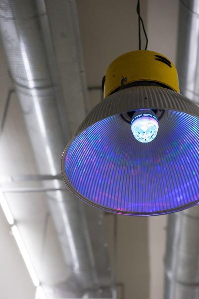 Untitled (Reflectors), 2018, industrial reflectors, RGB rotating light bulbs, variable dimensions